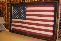 Framed American flag flown over the White House